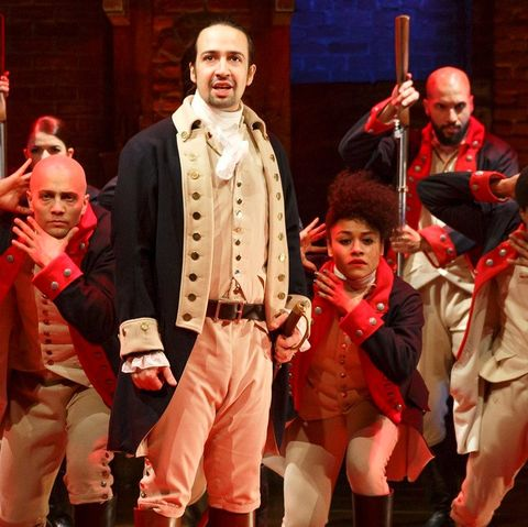 The bullet, a character in the play Hamilton stands behind him.